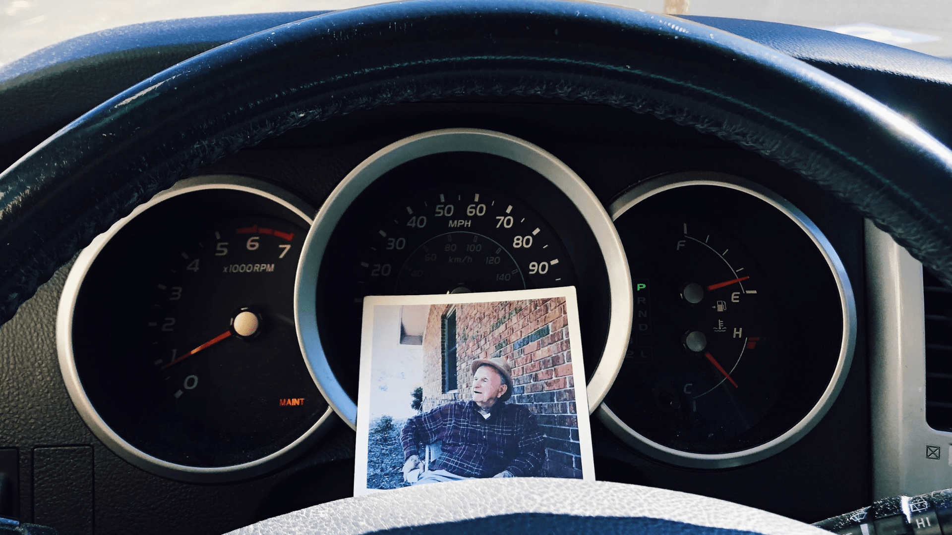 photo of papa on dashboard